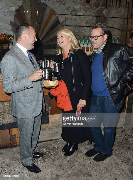 David Leppan Guillian and Bob Croizer arrive at the opening of Wahaca Presents Day of the Dead at the Old Vic Tunnels on October 31 2012 in London...
