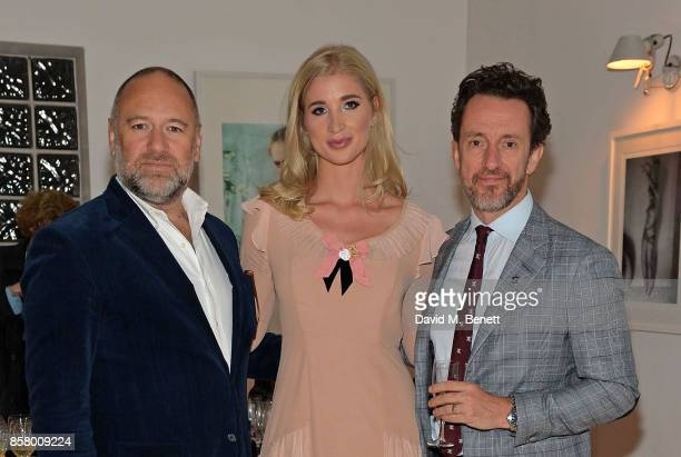 David Leppan Lucy von Goetz and Simon TallingSmith attend the opening of new art gallery Goetz Contemporary in Shoreditch on October 5 2017 in London...