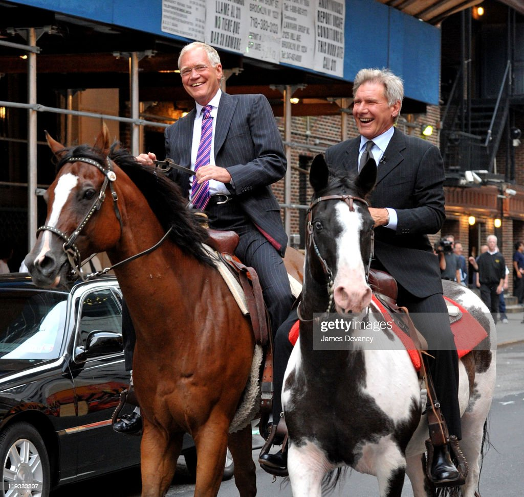 David Letterman and Harrison Ford ride horses named Chase and Shane outside the Ed Sullivan Theater on July 18, 2011 in New York City.
