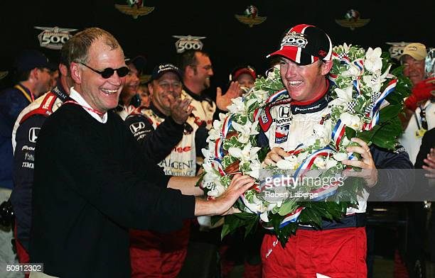 David Letterman, co-owner of the Rahal-Letterman Argent/Pioneer G Force Honda of Buddy Rice puts the wreath around the neck of Budddy Rice in a...