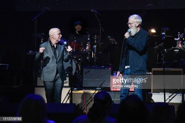 David Letterman jokes with Paul Shaffer on stage during the Fourth Annual LOVE ROCKS NYC benefit concert for God's Love We Deliver at Beacon Theatre...
