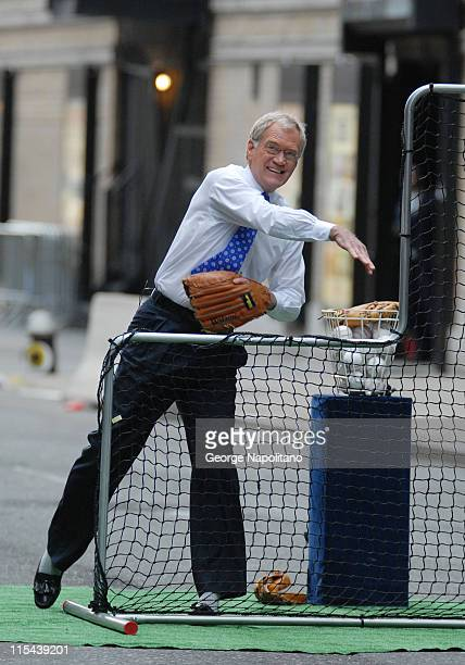 David Letterman pitches to New York Mets third baseman David Wright on 52nd St outside the Ed Sullivan Theater during a segment for 'Late Show with...