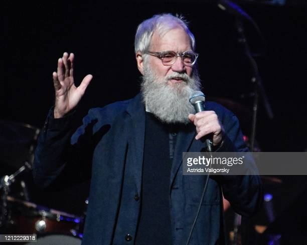 David Letterman tells jokes on stage during the Fourth Annual LOVE ROCKS NYC benefit concert for God's Love We Deliver at Beacon Theatre on March 12...