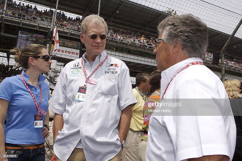 David Letterman, with assistant Stephanie Birkitt, talks to Mario Andretti before the start of the Indy 500 on May 27, 2007 in Speedway, Indiana.