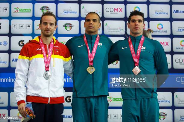 David Levecq of Spain Andre Brasil of Brazil and Andrews Rodrigues of Brazil pose after the Men's 100m Butterfly S10 Final during day 5 of the Para...
