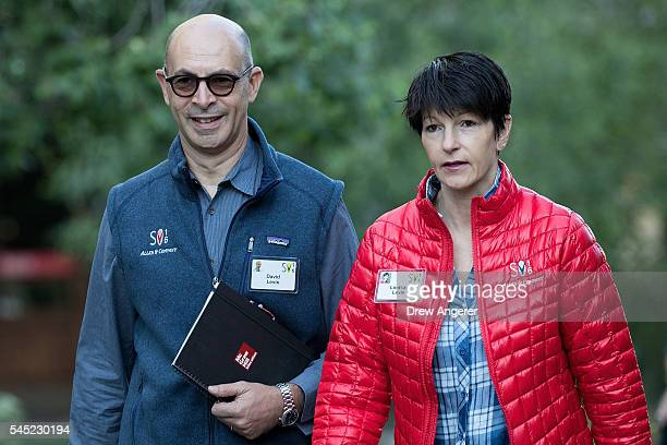 David Levin chief executive officer of McGrawHill Education walks with his wife Lindsay Levin as they attend the annual Allen Company Sun Valley...