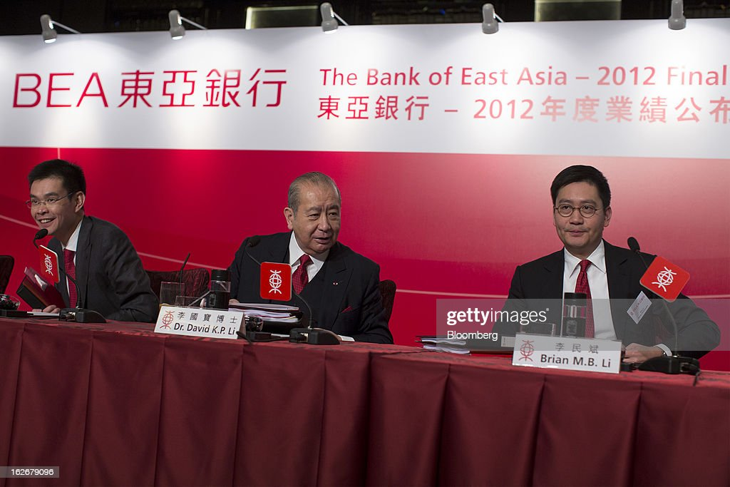 David Li, chairman and chief executive officer of Bank of East Asia Ltd. (BEA), center, Adrian Li, deputy chief executive officer, left, and Brian Li, deputy chief executive officer, attend the company's annual results news conference in Hong Kong, China, on Tuesday, Feb. 26, 2013. Bank of East Asia, Hong Kong's largest family-run lender, said 2012 profit jumped 39 percent as trading income climbed, helping offset a decline in profit from the mainland China business. Photographer: Jerome Favre/Bloomberg via Getty Images
