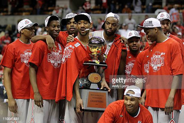 David Lighty and Jared Sullinger of the Ohio State Buckeyes celebrate along with their teammates with the Big Ten CHampionship trophy after they won...
