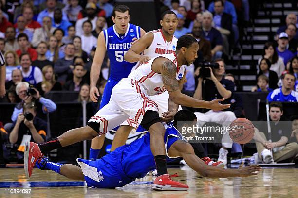 David Lighty of the Ohio State Buckeyes fights for the ball against Terrence Jones of the Kentucky Wildcats during the first half of the east...