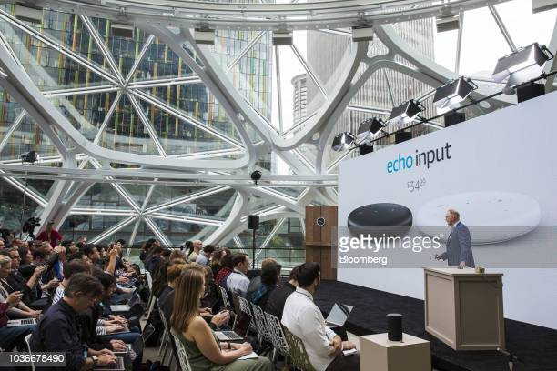David Limp senior vice president of devices and services at Amazoncom Inc presents the Amazon Echo Input device during an unveiling event at the...