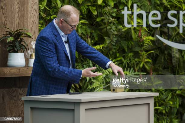 David Limp senior vice president of devices and services at Amazoncom Inc demonstrates an Amazon Smart Plug outlet during an unveiling event at the...