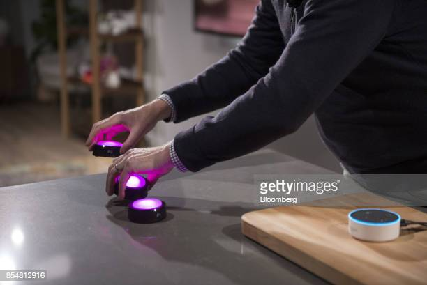 David Limp senior vice president of devices and services at Amazoncom Inc moves Echo Buttons during an Amazoncom Inc product reveal launch event in...
