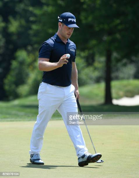 David Lingmerth acknowledges the gallery on the first green during the final round of the Quicken Loans National at TPC Potomac at Avenel Farm on...