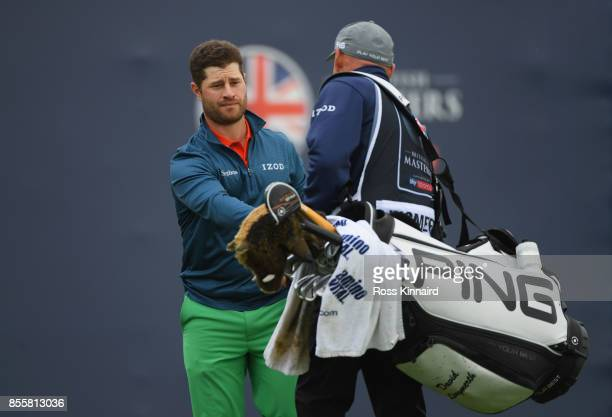 David Lingmerth of Sweden and his caddie shake hands on the 18th green during day three of the British Masters at Close House Golf Club on September...