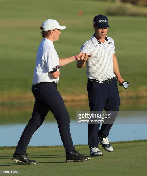 David Lingmerth of Sweden and Rasmus Lot are pictured together during the EDGA competition following the third roiund of the 2017 Portugal Masters at...