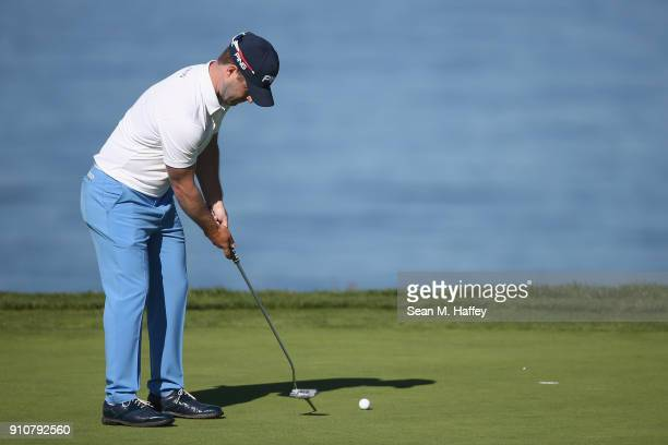 David Lingmerth of Sweden putts on the fourth green during the second round of the Farmers Insurance Open at Torrey Pines South on January 26 2018 in...