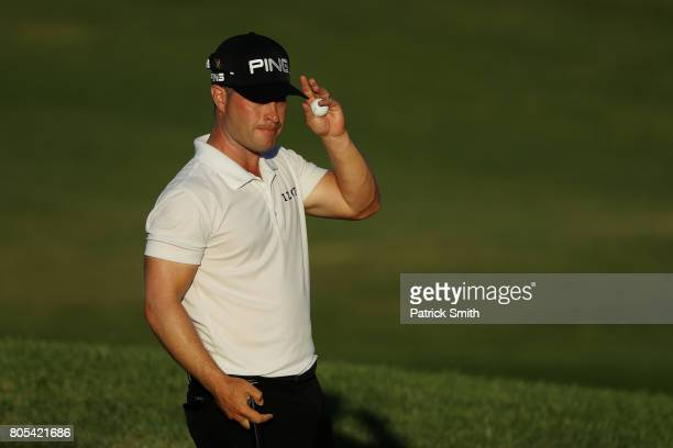David Lingmerth of Sweden reacts after finishing on the 18th green during the third round of the Quicken Loans National on July 1 2017 TPC Potomac in...