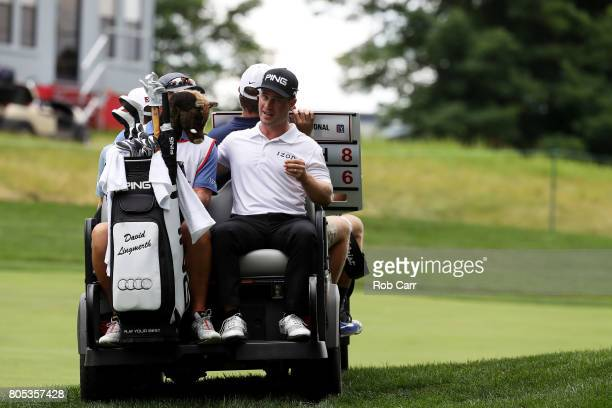 David Lingmerth of Sweden rides in the back of a cart after play was suspended due to weather during the third round of the Quicken Loans National on...