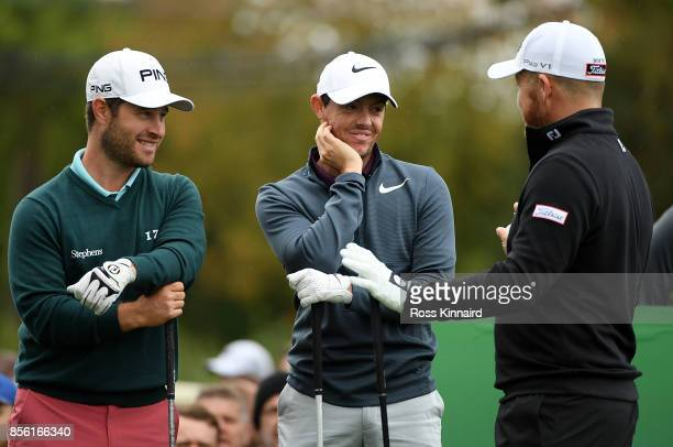 David Lingmerth of Sweden Rory McIlroy of Northern Ireland and George Coetzee of South Africa speak on the 1st tee during day four of the British...