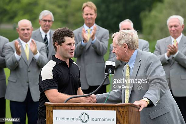 David Lingmerth waits is greeted by tournament host Jack Nicklaus after winning the Memorial Tournament presented by Nationwide at Muirfield Village...
