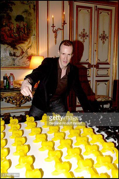 David Linx next to the vertebra shaped candles by the sulptor Pierre Buisseret - Party at the Belgian ambassador's place for the release of the book...