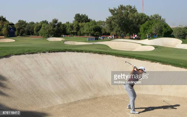 David Lipsky of the United States hits his second shot on the 1st hole during the final round of the DP World Tour Championship at Jumeirah Golf...