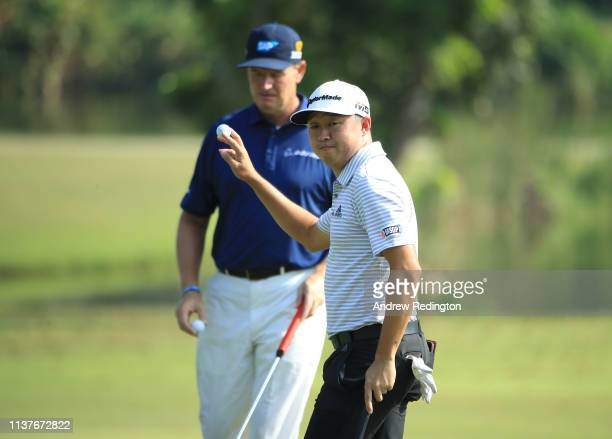 David Lipsky of the United States waves to the crowd on the first hole as Ernie Els of South Africa looks on on Day Three of the Maybank Championship...