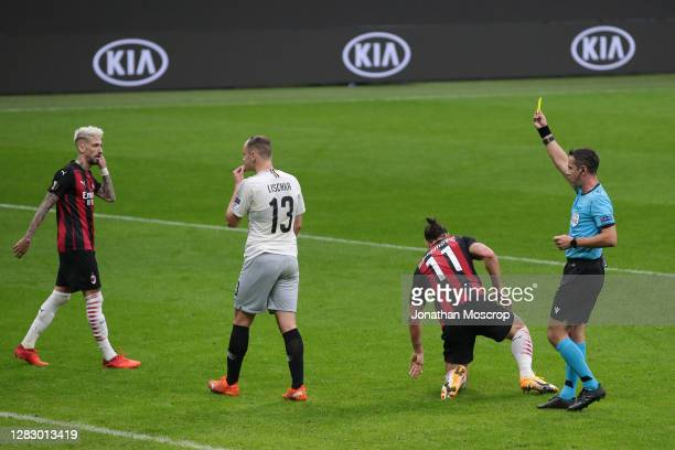 David Lischka of Sparta Praha is shown a yellow card by referee Halis Ozkahya of Turkey after fouling Zlatan Ibrahimovic of AC Milan to concede a...