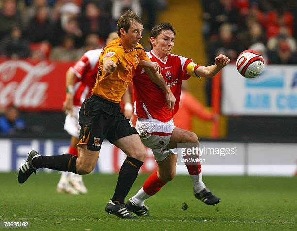 David Livermore of Hull City tries to tackle Matt Holland of Charlton Athletic during the Coca-Cola Championship match between Charlton Athletic and...