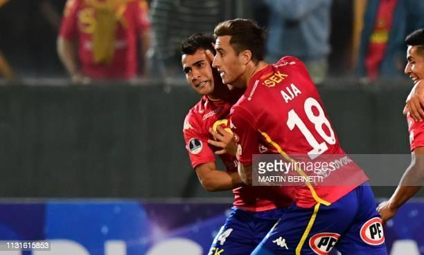 David Llanos of Chile's Union Espanola celebrates with Jose Aja after scoring against Ecuador's Mushuc Runa during their Copa Sudamericana football...