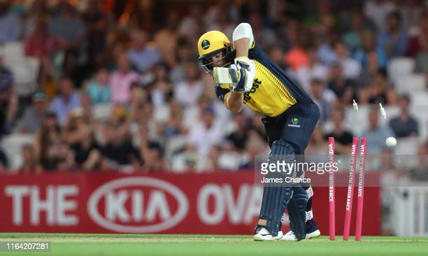 David Lloyd of Glamorgan is bowled by Tom Curran of Surrey during the Vitality Blast match between Surrey and Glamorgan at The Kia Oval on July 25,...