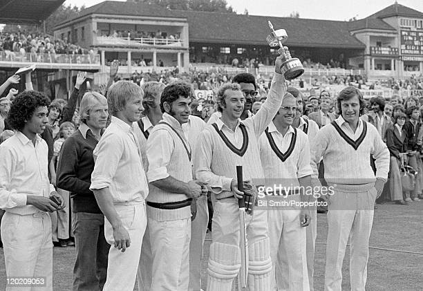 David Lloyd of Lancashire holding the trophy surrounded by his teammates after their victory over Middlesex in the Gillette Cup Final at Lord's...
