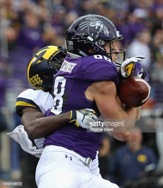 David Long of the Michigan Wolverines interferes with Bennett Skowronek of the Northwestern Wildcats at Ryan Field on September 29 2018 in Evanston...