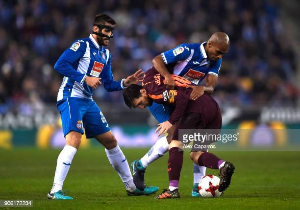 David Lopez and Naldo of Espanyol and Lionel Messi of Barcelona in action during the Spanish Copa del Rey Quarter Final First Leg match between...