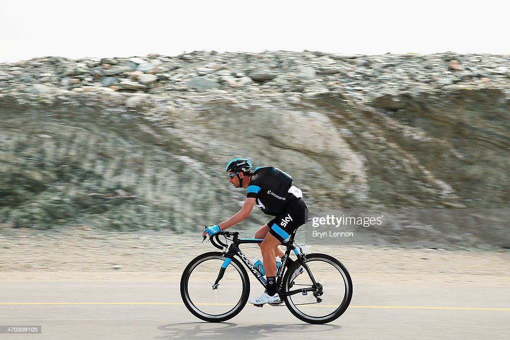 David Lopez Garcia of Spain and Team SKY collects water bottles for his team mates during stage two of the Tour of Oman from Al Bustan to Quriyat on February 19, 2014 in Al Bustan, Oman.