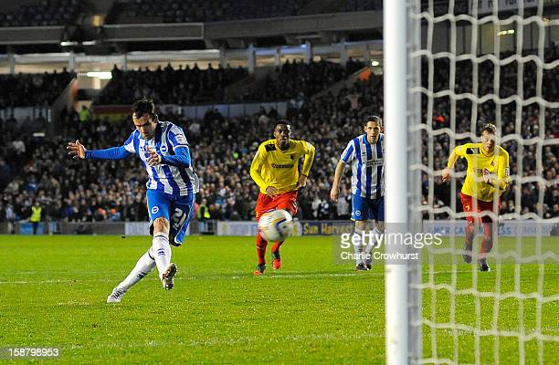 David Lopez of Brighton Hove Albion scores the teams first goal from the penalty spot during the npower Championship match between Brighton Hove...