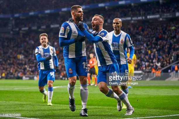 David Lopez of Espanyol celebrates after scoring his team's first goal with his teammate Sergi Darder during the Liga match between RCD Espanyol and...