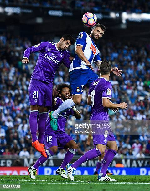 David Lopez of RCD Espanyol competes for a high ball with Alvaro Morata of Real Madrid CF during the La Liga match between RCD Espanyol and Real...