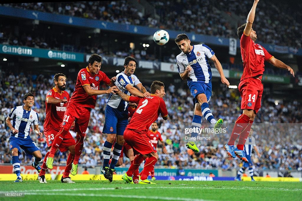 David Lopez of RCD Espanyol (2nd R) duels for a high ball during the La Liga match between RCD Espanyol and Getafe CF at Cornella-El Prat Stadium on September 29, 2013 in Barcelona, Spain.