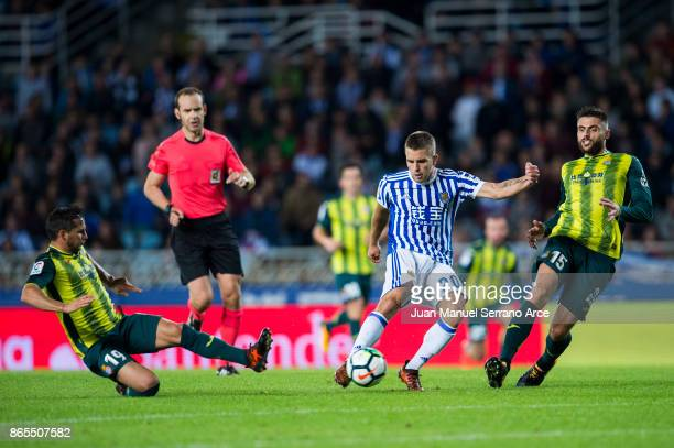 David Lopez of RCD Espanyol duels for the ball with Kevin Rodrigues of Real Sociedad during the La Liga match between Real Sociedad de Futbol and RCD...