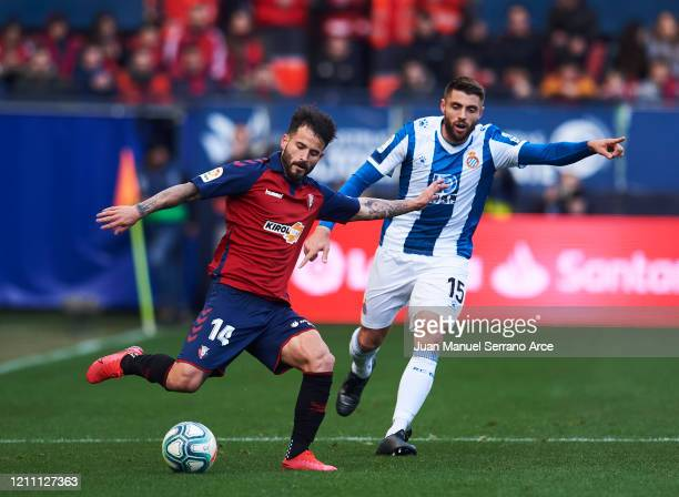 David Lopez of RCD Espanyol duels for the ball with Ruben Garcia of CA Osasuna during the Liga match between CA Osasuna and RCD Espanyol at El Sadar...