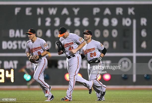 David Lough, Chris Parmelee and Steve Pearce of the Baltimore Orioles celebrate their 6-4 win over the Boston Red Sox at Fenway Park on June 23, 2015...
