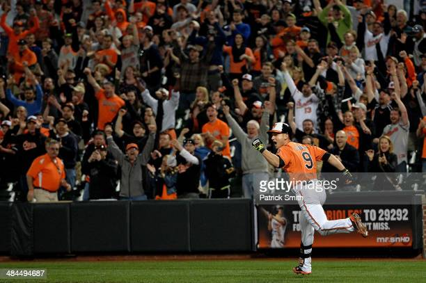 David Lough of the Baltimore Orioles celebrates as he hits the gamewinning RBI single to score teammate Stephen Lombardozzi against the Toronto Blue...