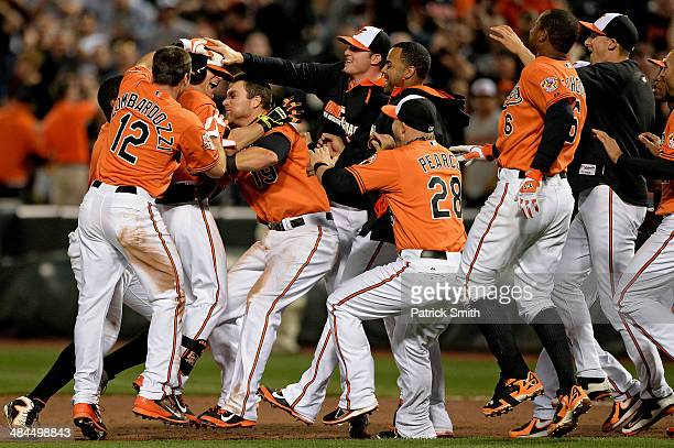 David Lough of the Baltimore Orioles is mobbed by teammates after hitting the gamewinning RBI single to score teammate Stephen Lombardozzi against...