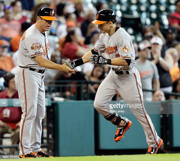 David Lough of the Baltimore Orioles receives a handshake from third base coach Bobby Dickerson at Minute Maid Park on June 1 2014 in Houston Texas