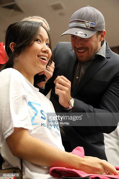 David Lucado assists a patient getting fitted for hearing aids at the Starkey Hearing Foundation Mission during GRAMMY Camp at University of Southern...