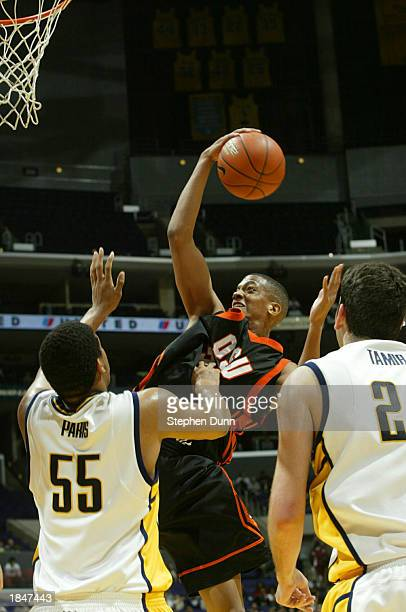 David Lucas of Oregon State goes up for the ball against David Paris of California during the Pac 10 tournament on March 13 2003 at the Staples...