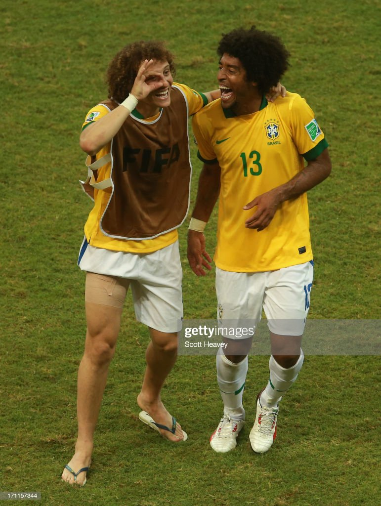 David Luiz (L) and Dante of Brazil celebrate victory after the FIFA Confederations Cup Brazil 2013 Group A match between Italy and Brazil at Estadio Octavio Mangabeira (Arena Fonte Nova Salvador) on June 22, 2013 in Salvador, Brazil.