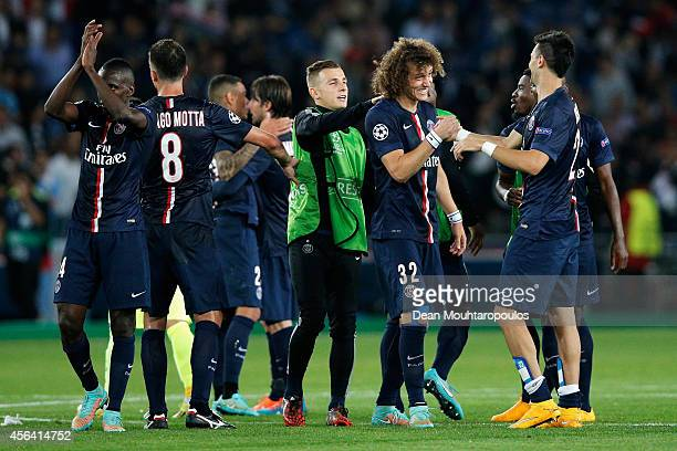 David Luiz and Javier Pastore of PSG shake hands as they celebrate victory in the Group F UEFA Champions League match between Paris SaintGermain v FC...
