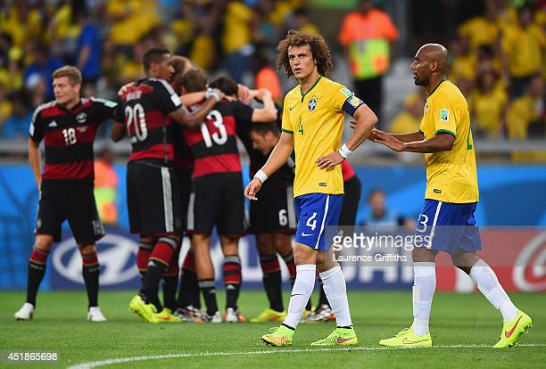 David Luiz and Maicon of Brazil react after allowing a goal during the 2014 FIFA World Cup Brazil Semi Final match between Brazil and Germany at...